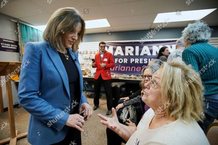 Democratic presidential candidate author Marianne Williamson talks to a member of her audience during an election stop at the Next Millennium Books & Gifts store in Omaha, Neb