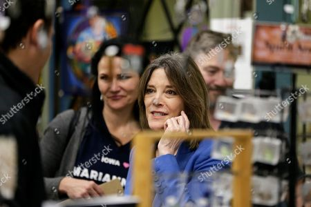 Democratic presidential candidate and author Marianne Williamson talks to shoppers following an election stop at the Next Millennium Books & Gifts store in Omaha, Neb