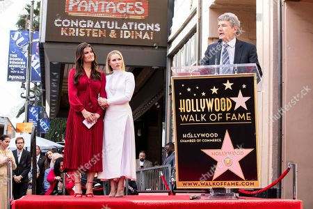 Chief creative officer and co-chairman of Walt Disney Studios Alan Horn (R) delivers a speech as US actresses Kristen Bell (C) and Idina Menzel (L) are honored with the 2,681st and 2682nd stars on the Hollywood Walk of Fame in Hollywood, California, USA, 19 November 2019. The stars were dedicated in the category of Motion Pictures and Live Theater/Performance.