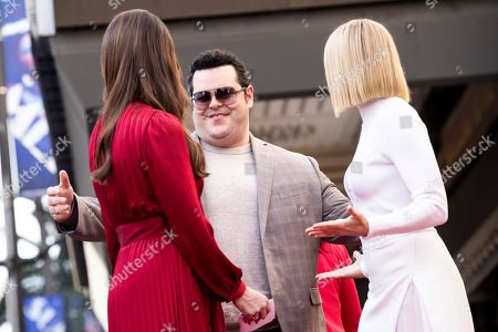 Stock Image of Josh Gad (C) arrives on stage to deliver a speech as US actresses Kristen Bell (R) and Idina Menzel (L) are honored with the 2,681st and 2682nd stars on the Hollywood Walk of Fame in Hollywood, California, USA, 19 November 2019. The stars were dedicated in the category of Motion Pictures and Live Theater/Performance.