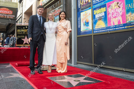 Kristen Bell (C) poses with US actress Jackie Tohn and US TV producer Michael Schur as she is honored with the 2,681st star on the Hollywood Walk of Fame in Hollywood, California, USA, 19 November 2019. The star was dedicated in the category of Motion Pictures.