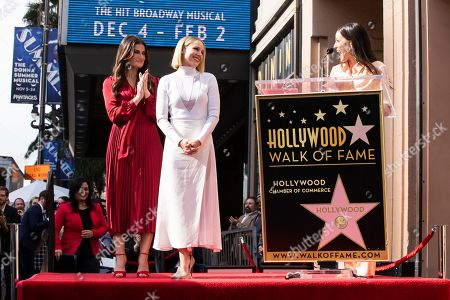 Stock Image of Jackie Tohn hugs (R) delivers a speech as US actresses Kristen Bell (C) and Idina Menzel (L) are honored with the 2,681st and 2682nd stars on the Hollywood Walk of Fame in Hollywood, California, USA, 19 November 2019. The stars were dedicated in the category of Motion Pictures and Live Theater/Performance.