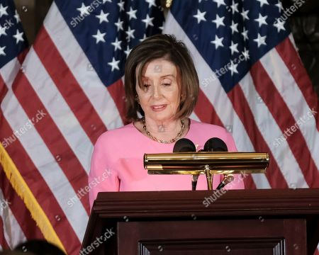 Stock Image of House Speaker Nancy Pelosi of Calif., delivers remarks during a ceremony to unveil a portrait honoring former House Speaker John Boehner on Capitol Hill, in Washington