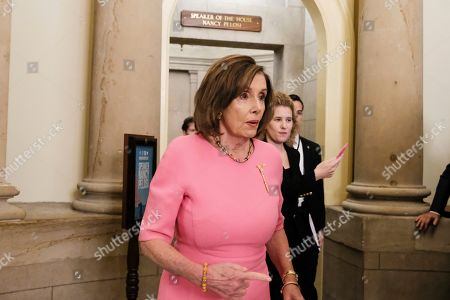Stock Photo of House Speaker Nancy Pelosi of Calif., attends a ceremony to unveil a portrait honoring former House Speaker John Boehner on Capitol Hill, in Washington