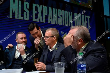 Nashville SC assistant general manager, Ally MacKay, left, general manager Mike Jacobs, head coach Gary Smith, and CEO Ian Ayre talk before making the team's first selection during the Major League Soccer expansion draft, in Nashville, Tenn