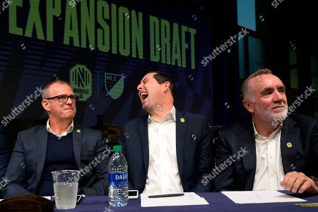 Nashville SC general manager Mike Jacobs, center, laughs with head coach Gary Smith, left, and CEO Ian Ayre, right, talk before making the team's first selection during the Major League Soccer expansion draft, in Nashville, Tenn