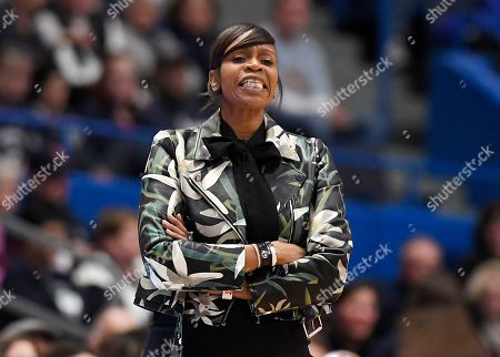 Virginia head coach Tina Thompson reacts during the second half of an NCAA college basketball game against Connecticut, in Hartford, Conn