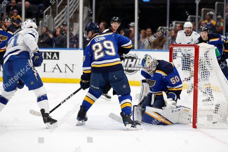 Stock Picture of Tampa Bay Lightning's Anthony Cirelli, left, scores past St. Louis Blues goaltender Jordan Binnington, right, and Vince Dunn (29) during the first period of an NHL hockey game, in St. Louis