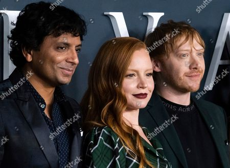 "M. Night Shyamalan, Lauren Ambrose, Rupert Grint. M. Night Shyamalan, from left, Lauren Ambrose and Rupert Grint attend the Apple TV Plus world premiere of ""Servant,"" at BAM Howard Gilman Opera House, in New York"