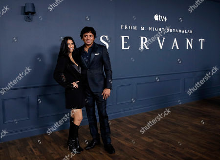 Stock Picture of M. Night Shyamalan (R) and his wife Bhavna Vaswani (L) pose at the AppleTV+ global premiere event for the television show Servant at BAM Howard Gilman Opera House in New York, USA, 19 November 2019.