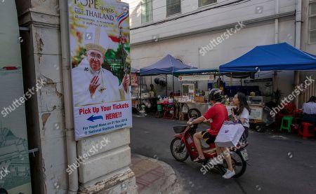 A poster of Pope Francis is displayed in a street corner in Bangkok, Thailand, . Pope Francis arrives in Thailand on Wednesday for the first visit here by the head of the Roman Catholic Church since St. John Paul II in 1984