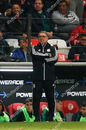 Mexico's national soccer team coach Gerardo Martino looks at his players during a CONCACAF Nations League soccer match against Bermudas at Nemesio Diez Stadium in Toluca, Mexico, . Mexico won 2-1