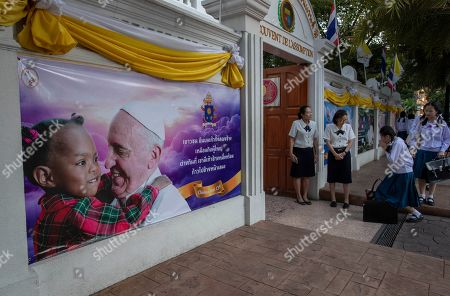 School children greet their teachers at Assumption convent, decorated with posters of Pope Francis in Bangkok, Thailand, . Pope Francis arrives in Thailand on Wednesday for the first visit here by the head of the Roman Catholic Church since St. John Paul II in 1984