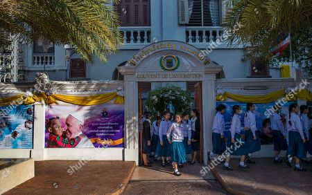 School children walk at Assumption convent, decorated with posters of Pope Francis in Bangkok, Thailand, . Pope Francis arrives in Thailand on Wednesday for the first visit here by the head of the Roman Catholic Church since St. John Paul II in 1984