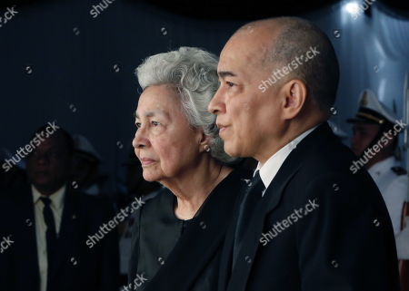 Stock Photo of Cambodia's King Norodom Sihamoni (R) and the queen mother Norodom Monineath Norodom Monineath (L) attend Princess Norodom Buppha Devi funeral rites, one of late King Norodom Sihanouk's daughters, in Phnom Penh, Cambodia, 20 November 2019. Cambodia's Royal Palace announced on 18 November that Princess Norodom Buppha Devi died aged 76 at a hospital in Thailand. She served as Cambodia's minister of culture from 1998 to 2004.