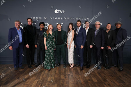 Stock Photo of Eddy Cue, SVP Internet Software and Services for Apple, Zack Van Amburg, Head of Worldwide Video for Apple, M Night Shyamalan, Director/Executive Producer, Lauren Ambrose, Rupert Grint, Nell Tiger Free, Toby Kebbell, Jamie Erlicht, Head of Worldwide Video for Apple, Tony Basgallop, Writer/Creator/Executive Producer, Jason Blumenthal, Executive Producer, and Ashwin Rajan, Executive Producer, attend 'Servant' New York Premiere at BAM Howard Gilman Opera House on November 19, 2019 in Brooklyn. 'Servant' premieres exclusively on Apple TV+ on November 28.
