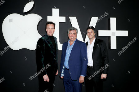 Stock Image of BROOKLYN, NEW YORK - November 19: Zack Van Amburg, Head of Worldwide Video for Apple, Eddy Cue, SVP Internet Software and Services for Apple, and Jamie Erlicht, Head of Worldwide Video for Apple, attend 'Servant' New York Premiere at BAM Howard Gilman Opera House on November 19, 2019 in Brooklyn. 'Servant' premieres exclusively on Apple TV+ on November 28.