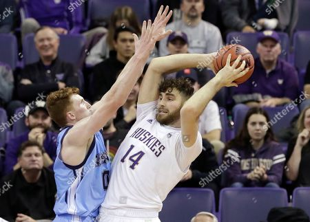 Sam Timmins, Andrew Fleming. Washington's Sam Timmins (14) looks for room to pass as Maine's Andrew Fleming defends during the second half of an NCAA college basketball game, in Seattle