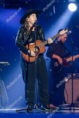 Serena Ryder performs on stage for students and educators