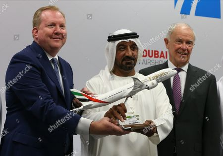 Sheikh Ahmed Bin Saeed Al Maktoum (C), President of Dubai Civil Aviation Authority, Chairman of Dubai Airports and Chairman and Chief Executive of Emirates Airline and Group, Stan Deal (L), CEO of Boeing Commercial Airplanes and Tim Clark (R), President of Emirates Airline pose after signing an agreement during the Dubai Airshow 2019 at Dubai World Central - Al Maktoum International Airport, in Jebel Ali, Dubai, United Arab Emirates, 20 November 2019.