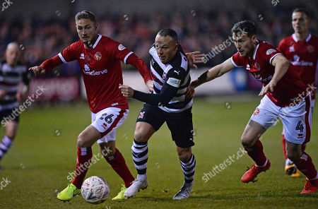 Steven Thompson of Darlington (centre) fends off Gary Liddle of Walsall