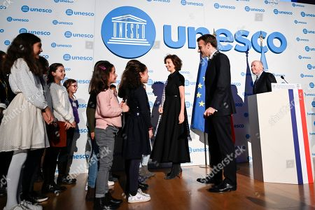 UNESCO Director-General Audrey Azoulay (3R), French President Emmanuel Macron (2R) and French Ombudsman (Defenseur des droits) Jacques Toubon (R) welcome children during the 30th anniversary of the Convention on the Rights of the Child (UNCRC) at the UNESCO in Paris, France, 20 November 2019.