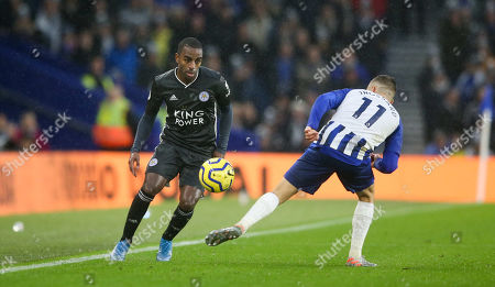 Ricardo Pereira of Leicester City chips the ball past Leandro Trossard of Brighton & Hove Albion