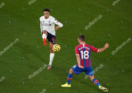 Stock Image of Trent Alexander-Arnold of Liverpool lifts the ball over James McArthur of Crystal Palace