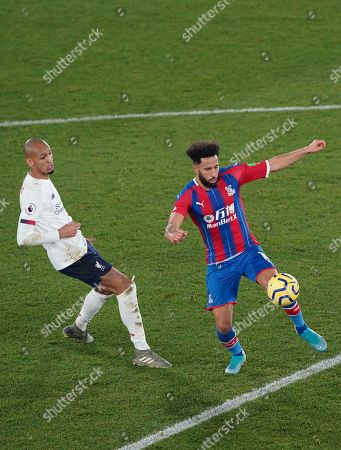 Andros Townsend of Crystal Palace and Fabinho of Liverpool
