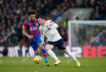 Andrew Robertson of Liverpool gets past Andros Townsend of Crystal Palace