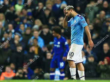 Sergio Aguero of Manchester City looks dejected as he leaves the game through injury