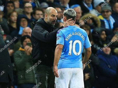 Manchester City manager Pep Guardiola with Sergio Aguero who leaves the game through injury