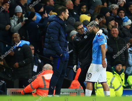 Sergio Aguero of Manchester City leaves the game through injury