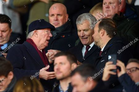 Sir Alex Ferguson, David Gill and Ed Woodward of Manchester United talk in the stands.