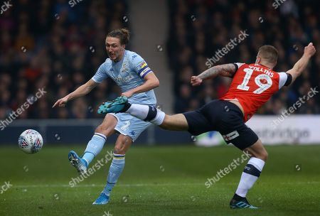 Leeds United's Luke Ayling battles with Luton Town's James Collins