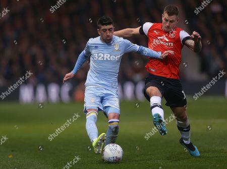 Leeds United's Pablo Hernandez battles with Luton Town's James Collins