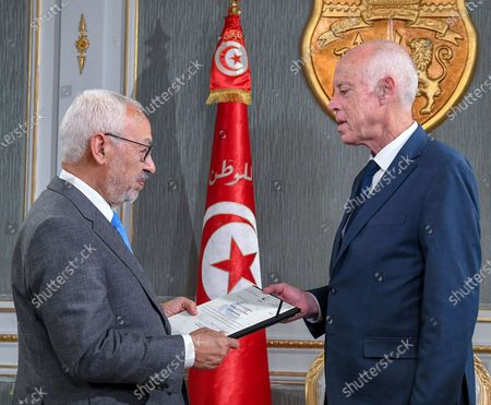 Stock Image of Tunisian President Kais Saied (R) meets with Tunisian new Parliament President Rached Ghannouchi during a meeting at the Carthage Palace in Tunis.