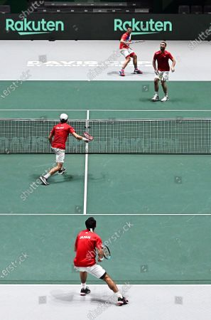 Japan's Yasutaka Uchiyama (front R) and Ben McLachlan (front L) in action against Serbia's Janko Tipsarevic and Viktor Troicki (back) during their doubles match in the group stage tie between Serbia and Japan at the Davis Cup Finals tennis tournament at the Caja Magica facilities in Madrid, Spain, 20 November 2019.