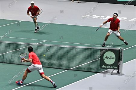 Japan's Ben McLachlan (back L) and Yasutaka Uchiyama (back R) in action against Serbia's Janko Tipsarevic and Viktor Troicki during their doubles match in the group stage tie between Serbia and Japan at the Davis Cup Finals tennis tournament at the Caja Magica facilities in Madrid, Spain, 20 November 2019.