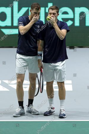Britain's Jamie Murray (L) and Neal Skupski react during a men doubles match of the Davis Cup finals against Wesley Koolhof and Jean Julien Rojer of the Netherlands at the Caja Magica facilities in Madrid, Spain, 20 November 2019.