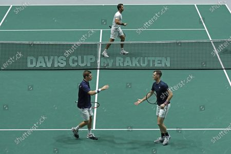 Great Britain's Jamie Murray (front-R) and Neal Skupski (front-L) react during a men doubles match of the Davis Cup finals against Wesley Koolhof and Jean Julien Rojer of the Netherlands at the Caja Magica facilities in Madrid, Spain, 20 November 2019.