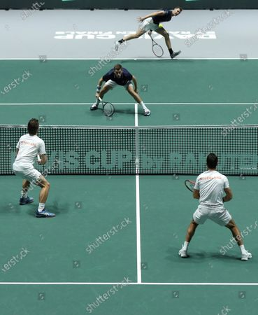 Great Britain's Jamie Murray (back-R) and Neal Skupski (back-C) in action against Wesley Koolhof (front-L) and Jean Julien Rojer (front-R) of the Netherlands during a men doubles match of the Davis Cup finals at the Caja Magica facilities in Madrid, Spain, 20 November 2019.