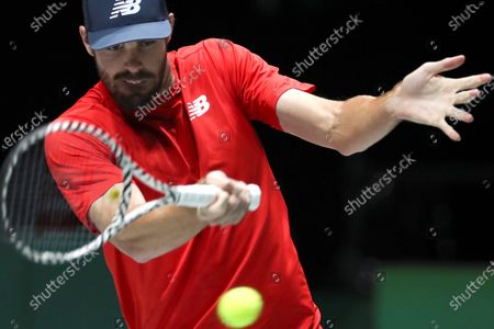 Reilli Opelka of US in action against Fabio Fognini of Italy during their singles match in the group stage tie between United States and Italy at the Davis Cup Finals tennis tournament at the Caja Magica facilities in Madrid, Spain, 20 November 2019.
