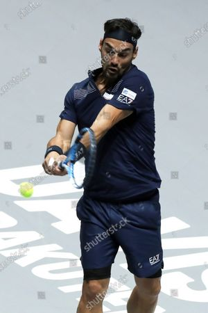 Fabio Fognini of Italy in action against Reilli Opelka of US during their singles match in the group stage tie between United States and Italy at the Davis Cup Finals tennis tournament at the Caja Magica facilities in Madrid, Spain, 20 November 2019.