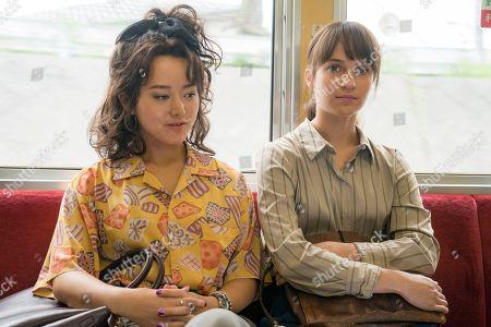Stock Picture of Kiki Sukezane as Natsuko and Alicia Vikander as Lucy Fly