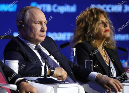 Russian President Vladimir Putin (L) and  Chairman of the Board of Eni oil and gas company Emma Marcegaglia attend an annual VTB Capital 'Russia Calling!' Investment Forum in Moscow, Russia, 20 November 2019. The 11th annual VTB Capital 'Russia Calling!' Investment Forum takes place on 20-22 November 2019.