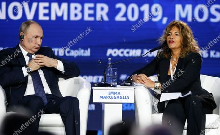 Stock Picture of Russian President Vladimir Putin (L) and Chairman of the Board of Eni oil and gas company Emma Marcegaglia (R) attend an annual VTB Capital 'Russia Calling!' Investment Forum in Moscow, Russia, 20 November 2019. The 11th annual  VTB Capital 'Russia Calling!' Investment Forum takes place on 20-22 November 2019.