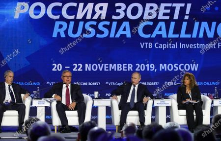 Stock Photo of (L-R) Founder, Chairman and Chief Executive Officer of Moelis and Company Ken Moelis, President and Chairman of VTB Bank Management Board Andrei Kostin, Russian President Vladimir Putin, Chairman of the Board of Italian company Eni Emma Marcegaglia attend an annual VTB Capital 'Russia Calling!' Investment Forum in Moscow, Russia, 20 November 2019. The 11th annual VTB Capital 'Russia Calling!' Investment Forum takes place on 20-22 November 2019.