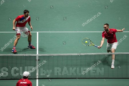 Serbia's Janko Tipsarevic, left, and Viktor Troicki play against Japan's Ben McLachlan and Yasutaka Uchiyama during their Davis Cup tennis double match in Madrid, Spain