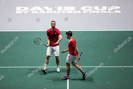 Serbia's Janko Tipsarevic, right, and Viktor Troicki play against Japan's Ben McLachlan and Yasutaka Uchiyama during their Davis Cup tennis double match in Madrid, Spain